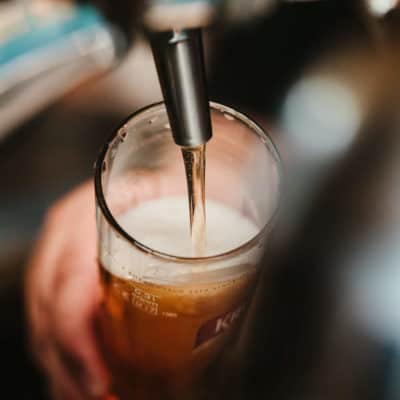 Close up photo of a draft beer being poured