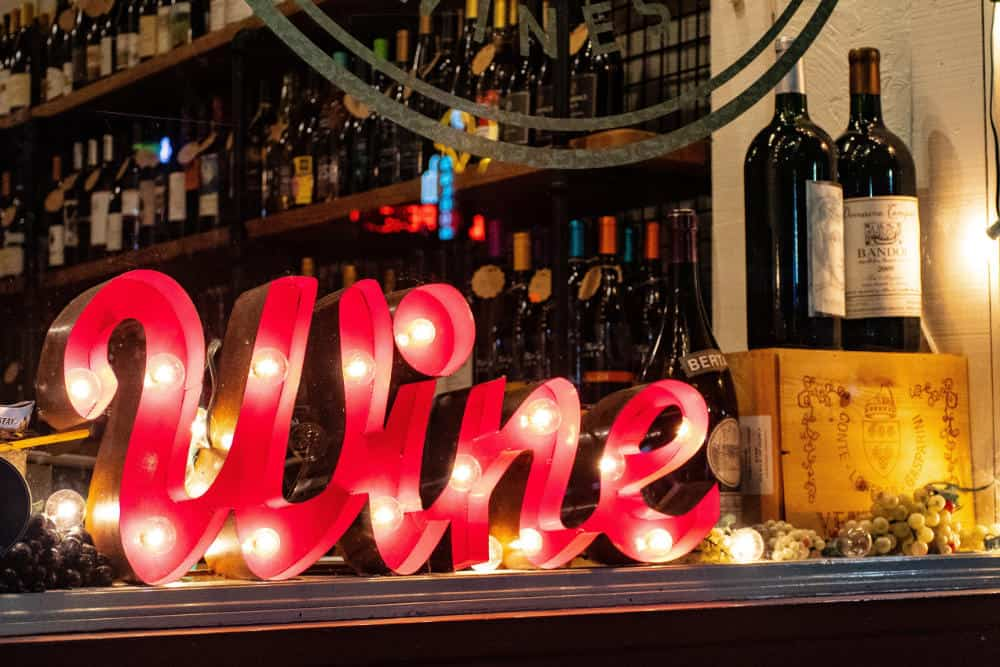 "Photo of a marquee sign that reads ""Wine"""